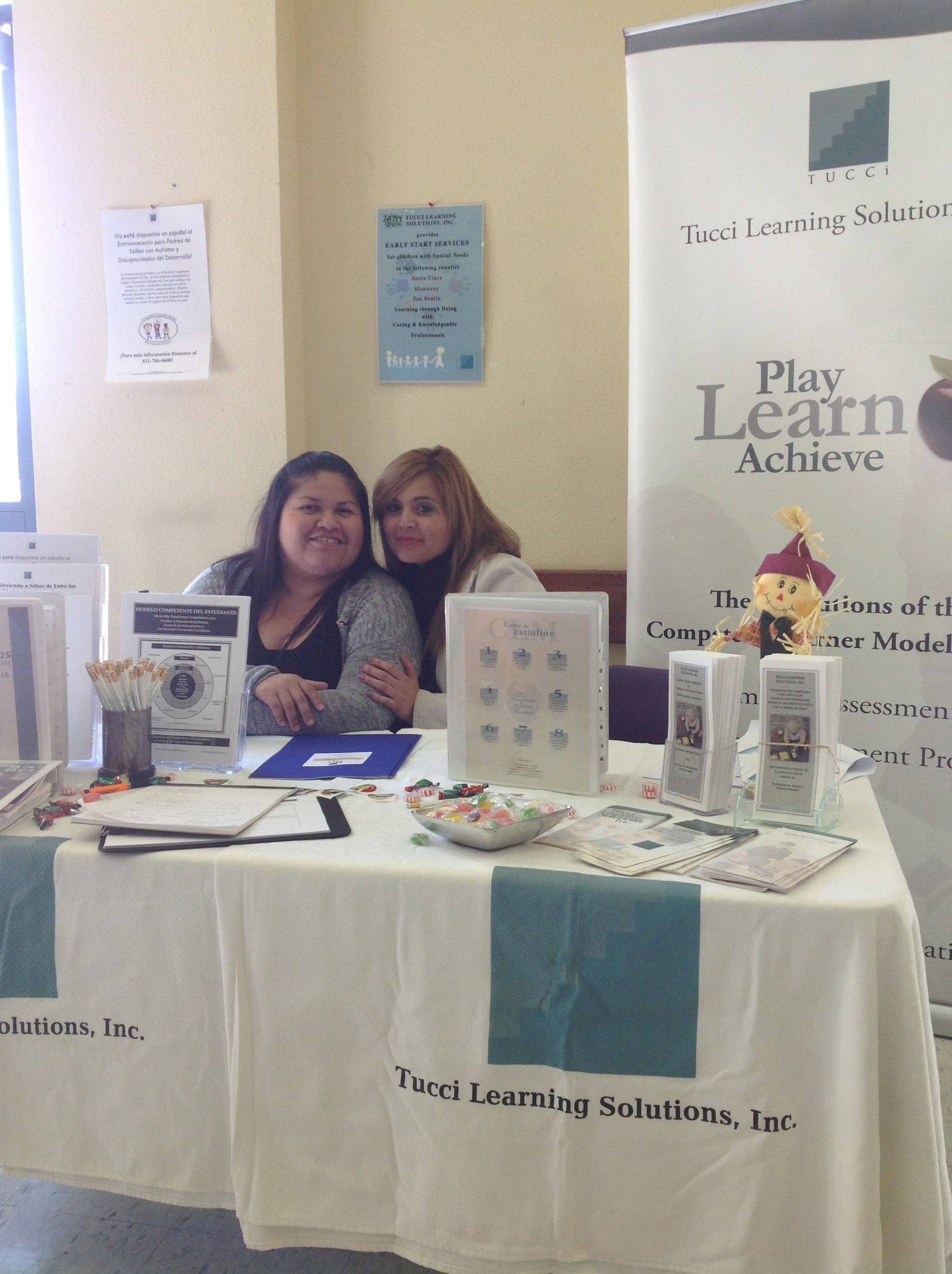 Cynthia Valencia and Denise Jaime at our table booth