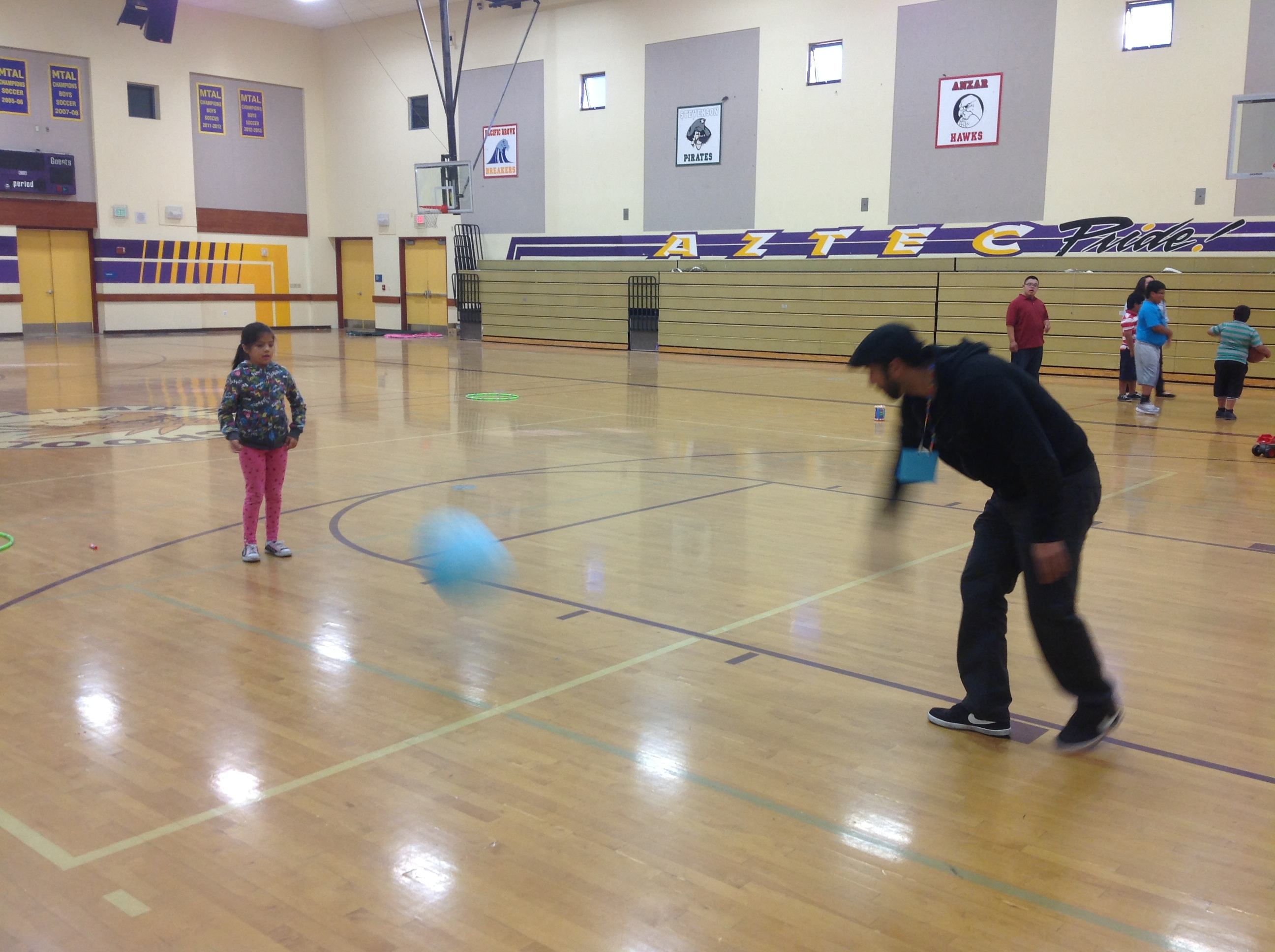 Trozki Varela playing ball with one of the kids